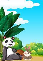 Panda e coniglio in giardino vettore