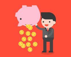 Uomo d'affari che trasportano monete piggy bank e oro, risparmiando il concetto di denaro