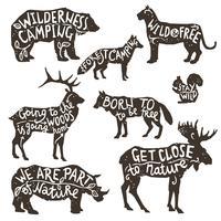 Sagome di animali selvatici con lettering vettore