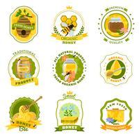 Emblemi di miele impostati vettore