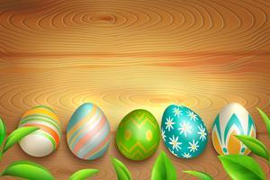 Uova di Pasqua su fondo in legno vettore
