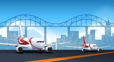 Due aerei che parcheggiano sulla pista vettore