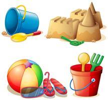 Giocattoli secchi e castello di sabbia