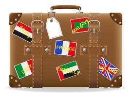 vecchia valigia per viaggio ed etichetta illustrazione vettoriale