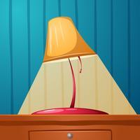 La lampada da tavolo è sul tavolo. Carte da parati nella striscia.