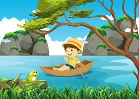 Imbarcazione a remi del ragazzo da solo nel lago