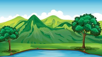 Scena di sfondo con la montagna e lo stagno verdi