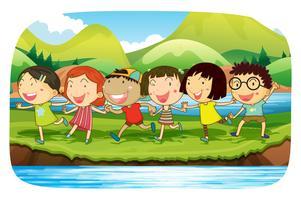Bambini che giocano nella natura vettore