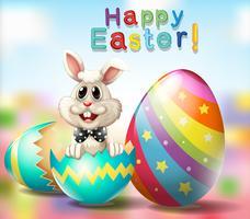 Felice poster di Pasqua con uova di coniglio e arcobaleno