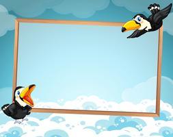 Disegno del bordo con due tucani in volo
