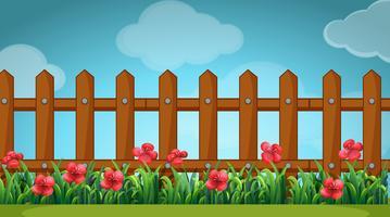 Scena con recinzione in legno nel giardino vettore