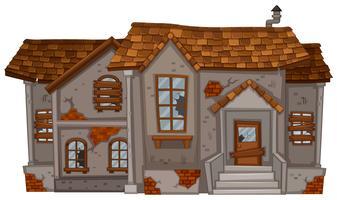Vecchia casa di mattoni con tetto marrone