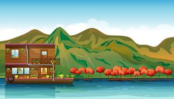 Un fiume e una casa galleggiante vettore