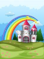 Un castello in cima alla collina con un arcobaleno vettore