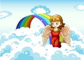 Un angelo nel cielo vicino all'arcobaleno vettore