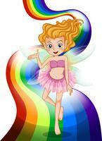 Una fata in piedi presso l'arcobaleno