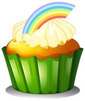 Un cupcake con arcobaleno vettore