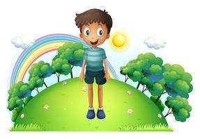 Un ragazzo in piedi in mezzo alla collina vettore