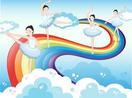 Ballerini di balletto nel cielo con un arcobaleno