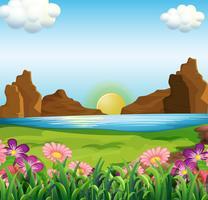Una vista del fiume e dei bellissimi fiori vettore
