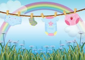 Appendere i vestiti del bambino sotto l'arcobaleno vettore