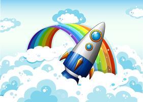 Un razzo vicino all'arcobaleno vettore
