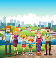 Una famiglia sulla riva del fiume vettore