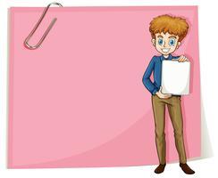 Un ragazzo che tiene un contrassegno vuoto che si leva in piedi davanti ad un documento vuoto