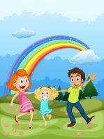 Una famiglia in cima alla collina e un arcobaleno nel cielo vettore