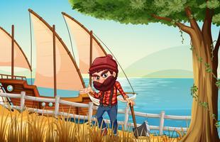 Un boscaiolo in piedi sulla riva del fiume con una nave di legno