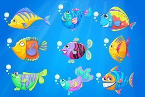 Nove pesci colorati sotto l'oceano profondo vettore