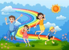 Una famiglia in cima alla collina che gioca con l'arcobaleno vettore