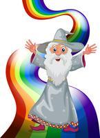 Un mago vicino all'arcobaleno vettore