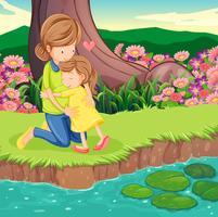 Una madre che abbraccia sua figlia sulla riva del fiume vettore