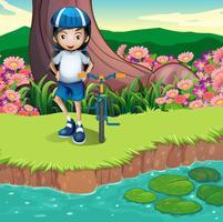 Una ragazza e la sua bicicletta sulla riva del fiume