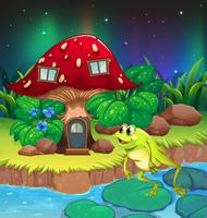 Una rana che salta vicino alla casa dei funghi rossa vettore