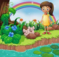 Una piccola ragazza sulla sponda del fiume con funghi