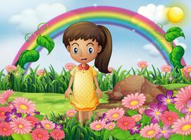 Una ragazza in giardino con un arcobaleno sul retro vettore