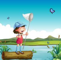 Una ragazza che cattura la farfalla