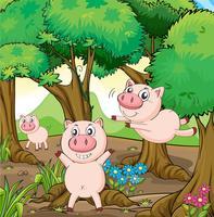 Tre maiali che giocano nella foresta vettore