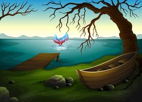 Una barca sotto l'albero vicino al mare con un grosso pesce vettore