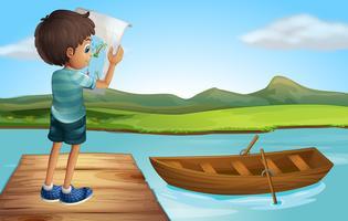 Un ragazzo al fiume con una barca di legno vettore