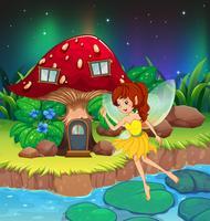 Una fata che vola vicino alla casa dei funghi rossa