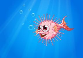 Un pesce palla rosa nell'oceano vettore