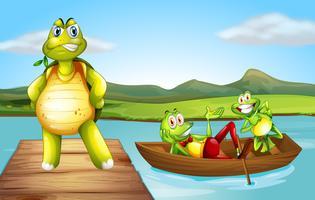 Una tartaruga al ponte e le due rane giocose sulla barca vettore