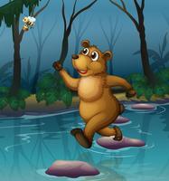 Un orso e un'ape nella foresta vettore