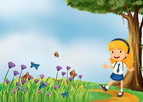 Una ragazza giovane scuola nel giardino con farfalle