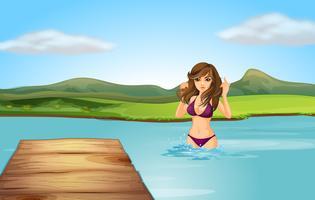 Una ragazza in spiaggia con un trampolino di legno vettore