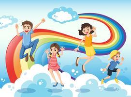 Una famiglia felice vicino all'arcobaleno vettore