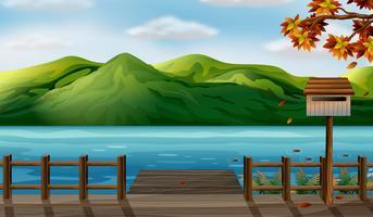 Una vista sul mare e sulle alte montagne vettore